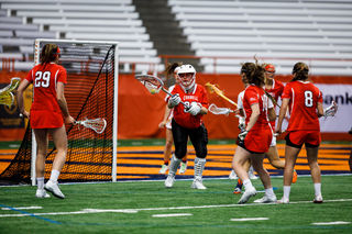 Cornell's Poullott carries the ball in her stick.