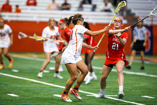 An SU defender closely guards Cornell's Kristy Gilbert.
