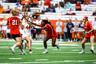 Mary Rahal tries to avoid the stick of a Cornell defender.
